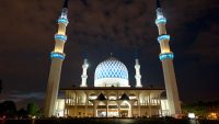 Frontal view of the Masjid Shah Alam Blue Mosque at night.