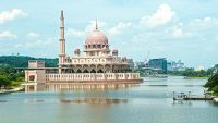 The distinctive pink dome with rose-tinted granite of the mosque stands out among Putrajaya's skyline.