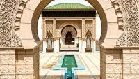 A fountain running through an intricately carved archway at the Astaka Morocco.